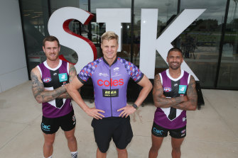 Nick Riewoldt was back at St Kilda on Tuesday, with Tim Membrey (left) and Brad Hill (right) to promote fundrasing for Maddie's Match.