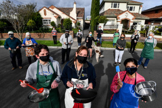 Neighbours on Chloris Crescent in Caulfield cook together via Zoom and take turns to teach. (Front left to right) James and his mumJennifer HuntandBindya Bedi.