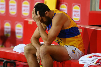 A dejected Eagles forward Josh Kennedy sits on the bench.