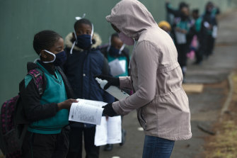 Students go through the regular morning checks on their arrival at the Melpark Primary School in Johannesburg, earlier this month.