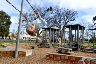 Louis Cummings, 8, enjoys one last swing at Curtain Square park in Carlton on Monday.
