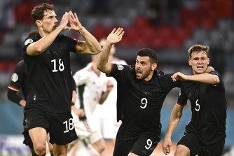 Leon Goretzka, left, celebrates the goal that kept Germany in Euro 2020.