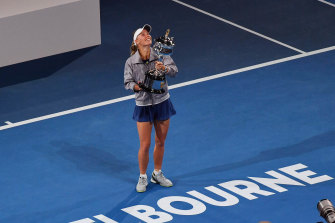 Caroline Wozniacki celebrates with the trophy after beating Simona Halep in the Australian Open women's final in 2018.