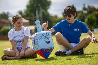 Twelve-year-old Keren Schauder and David Loven the festival in Princes Park, Caulfield South.