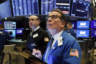 Traders Andrew Silverman, left, and Sal Suarino on the floor of the New York Stock Exchange.