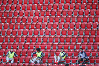 Bayern Munich substitutes wear face masks and maintain social distancing in the otherwise empty stands as the team returned to the Bundesliga against FC Union Berlin on Sunday.