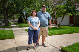 """Elections in our country have become a do-or-die team sport"": Peggy and Frank DeMercurio outside their home in Macomb County, Michigan."