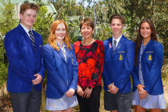 In a photo taken before social distancing began, Koonung Secondary College principal Marianne Lee is seen with  students Tim Woodfield (vice captain), Sarah Whitebrook (school captain),  Blair Tink (school captain), Ellie Dooley (vice captain).