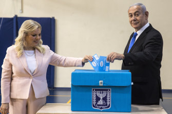 Israeli Prime Minister Benjamin Netanyahu and his wife Sarah cast their votes in Jerusalem.