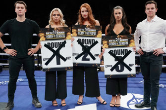 Horn v Zerafa promoters pose with the three women who will no longer be holding the cards at Saturday night's boxing match in Bendigo.