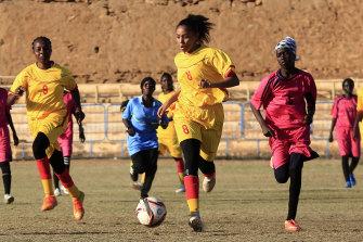 Sudanese al-Difaa, in pink, and al-Sumood women's teams play in Omdurman, Khartoum's twin city, Sudan.