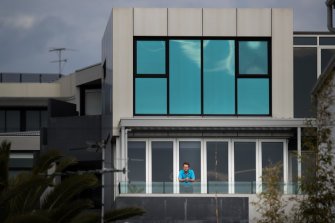 Neill Fitzpatrick on the balcony of his Port Melbourne apartment. Rates on his property have not fallen, despite cladding needing to be rectified on it.