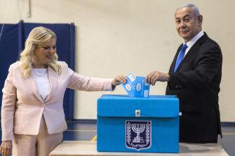 Israeli Prime Minister Benjamin Netanyahu and his wife Sarah cast their votes in Jerusalem.