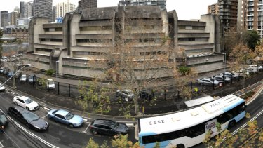 Empty spots are seen inside the secure parking of the Surry Hills police station.