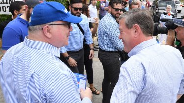 Tim Nicholls and George Brandis campaigning in Ascot on election day.
