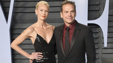 Sarah and Lachlan Murdoch pose at the Vanity Fair Oscars party in Hollywood.