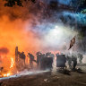 Hong Kong protesters, fleeing flames and the law, escape to Taiwan