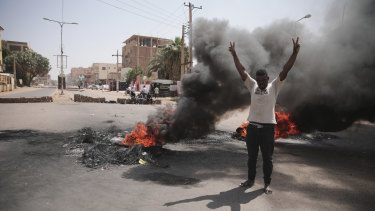People burn tires during a protest a day after the military seized power Khartoum, Sudan.