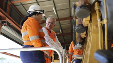 Prime Minister Scott Morrison and BHP apprentice Olivia Lodding at the BHP Future Fit academy in Perth on Wednesday.