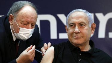 Israeli Prime Minister Benjamin Netanyahu receives a coronavirus vaccine at Sheba Medical Center in Ramat Gan, Israel  in December.