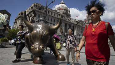 The Bund Bull in Shanghai, China's financial centre. China is gradually relaxing restrictions on foreigner participation in its massive financial sector.