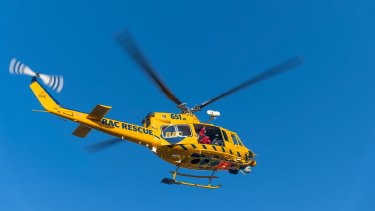 The rescue helicopter helped pull two survivors from the water.