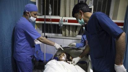 Blasts targeting Afghan school in Kabul kills dozens of students