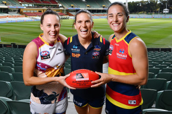 Brisbane Lions captain Emma Zielke with Adelaide's Chelsea Randall, who will miss the grand final because of concussion, and stand-in Crows captain Angela Foley on Friday.