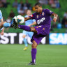 James Meredith of the Glory and Melbourne City's Craig Noone battle for the ball on Saturday night.