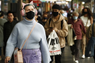 People wearing masks in the CBD.