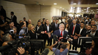 Israeli Prime Minister Benjamin Netanyahu speaks to the media after the vote.