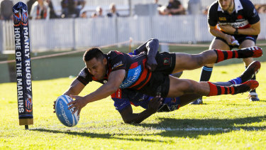 Kepu Lokotui scores a try for Norths in their victory over Manly on Saturday.
