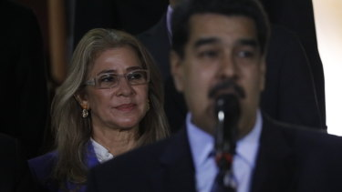 With first lady Cilia Flores in the background, Venezuela's President Nicolas Maduro speaks to the press last week.