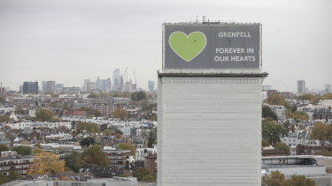 A general view of what remains of Grenfell Tower covered with hoardings following a severe fire in June 2017 in London, England.