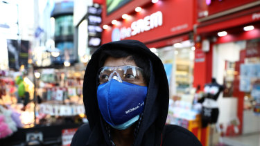 A man wears a mask to prevent the coronavirus in the Myungdong shopping district in Seoul.