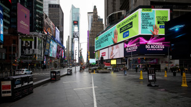 A public health service announcement notice is displayed at New York's Times Square.