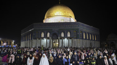 Palestinian Muslim worshippers pray during Laylat al-Qadr, or the night of destiny, in the holy fasting month of Ramadan, in front of the Dome of the Rock at the al-Aqsa Mosque compound in Jerusalem's Old City.