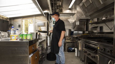 Local chef Sam cooks up breakfast for the police officers at Cann River on Wednesday.