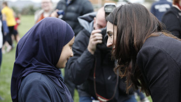 Prime Minister Jacinda Ardern greets students on Friday.