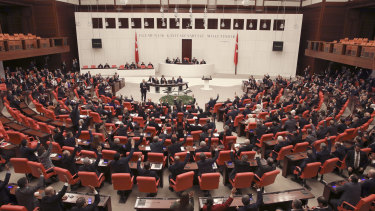 Members of Turkey's parliament vote to send Turkish troops to Libya to help the UN-supported government in Tripoli .