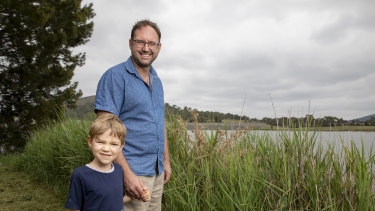 Ross Thompson, a University of Canberra researcher, is conducting ACT government-backed research at Lake Tuggeranong to determine why it gets frequent algae outbreaks. He is pictured here with his son Zac.