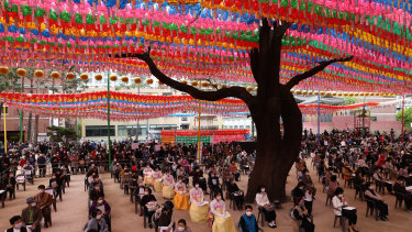 Koreans observe social distancing as they gather to celebrate Buddha's birthday and pray for the defeat of the coronavirus pandemic at Jogyesa Temple in Seoul, South Korea.