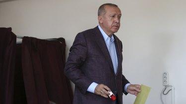 Turkey's President Recep Tayyip Erdogan casts his ballot in the re-run on Sunday.