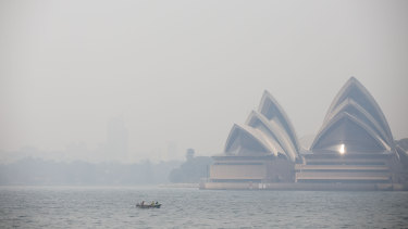 Smoke haze from nearby bushfires as seen on Sydney Harbour from Kirribilli in Sydney on December 19, 2019.