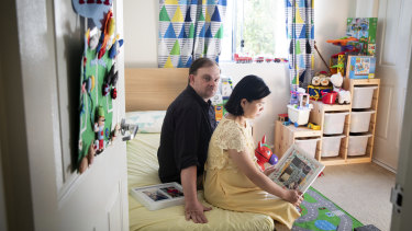Thomas and Tran Wheeler in their son Patrick's room. Patrick is unable to return home from Vietnam due to COVID-19.
