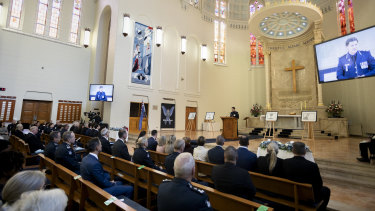 Mr Patton speaks at the private memorial service on Thursday.