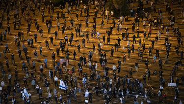 People keep social distancing during a protest against Prime Minister Benjamin Netanyahu in Tel Aviv.