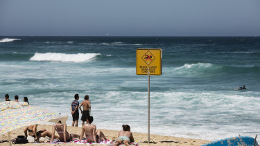 People cool off in the ocean despite the beach being closed by lifeguards due to dangerous conditions at Bronte Beach on Boxing Day.