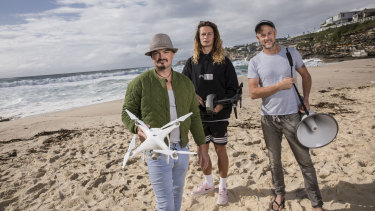"""A potential attack that we saved"": Carl Ellis (from left), Josh Marx and Jason Iggleden from Drone Shark at Tamarama Beach."