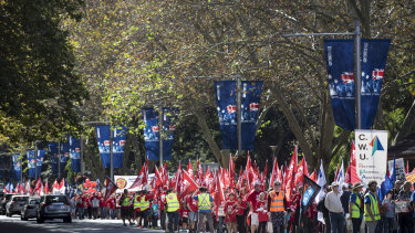 People walk down Elizabeth Street during the May Day rally in Sydney on May 6 this year.